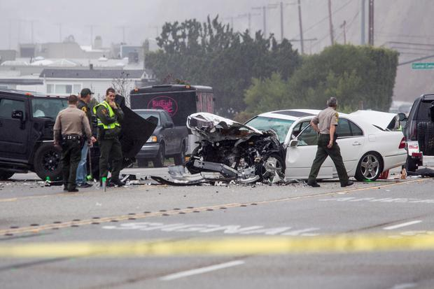 Los Angeles County Sheriff's deputies investigate the scene of a collision involving three vehicles in Malibu, as officials said former Olympian Bruce Jenner was a passenger in one of the cars involved in the Pacific Coast Highway crash that killed one person (AP Photo/Ringo H.W. Chiu)