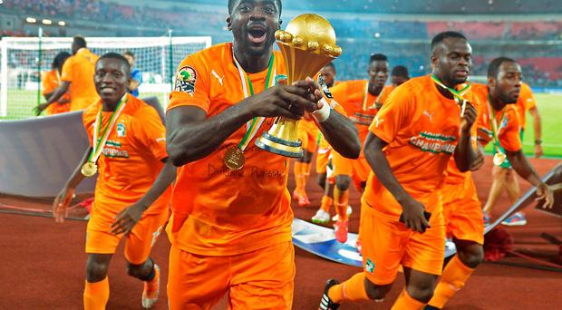 Ivory Coast defender Kolo Toure celebrates with the trophy after his side's victory in theAfrican Cup of Nations final against Ghana in Bata. AFP PHOTO / CARL DE SOUZACARL DE SOUZA/AFP/Getty Images