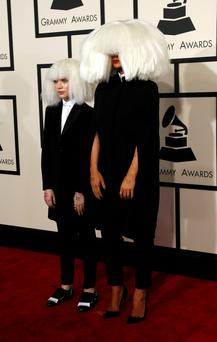 Singer Sia (R) and dancer Maddie Ziegler arrive at the 57th annual Grammy Awards in Los Angeles, California February 8, 2015.