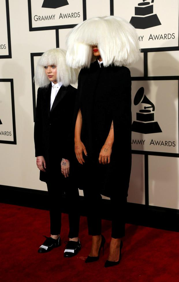 ec40285e6 LISTEN  Kanye s new song  Wolves  featuring Sia and Vic Mensa. Singer Sia  (R) and dancer Maddie Ziegler arrive at the 57th annual Grammy Awards