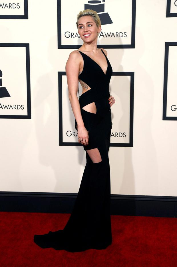 Singer Miley Cyrus arrives at the 57th annual Grammy Awards in Los Angeles, California February 8, 2015.