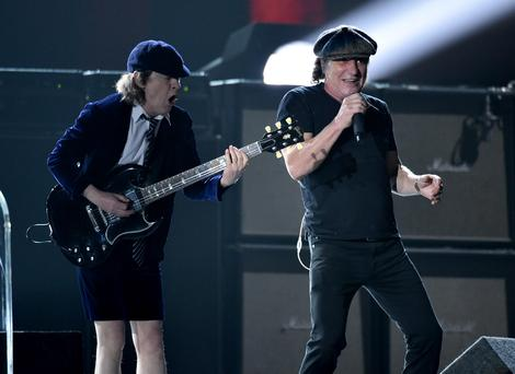 Angus Young, left, and Brian Johnson, of AC/DC, perform at the 57th annual Grammy Awards on Sunday, Feb. 8, 2015, in Los Angeles.