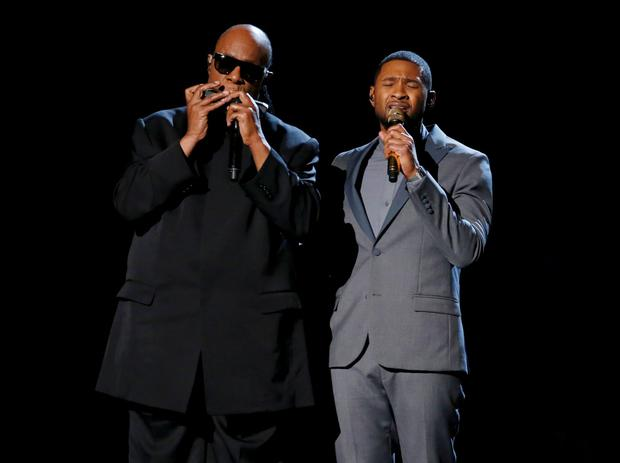 Usher (R) performs