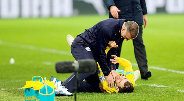 Under pressure: Nigel Pearson gets his hands round the throat of James McArthur