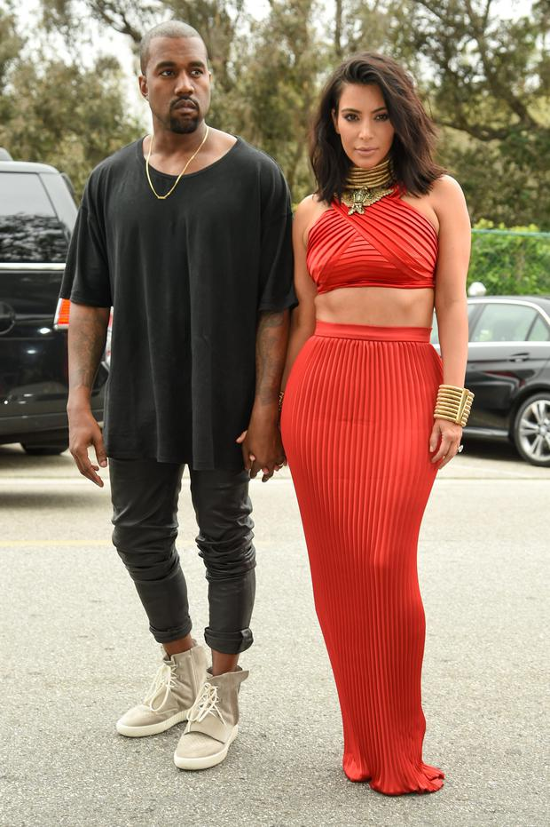 Kanye West, left and Kim Kardashian arrive at the Roc Nation Pre-Grammy Brunch at RocNation Offices on Saturday, Feb. 7, 2015, in Beverly Hills, Calif