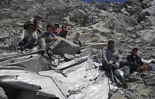 Group of Chilean mountaineers pose for a photo on what they say is the wreckage of a plane that crashed in the Andes 54 years ago, killing 24 people, including eight members of a professional soccer team, about 215 miles (360 kilometers) south of Santiago, Chile. (AP Photo/Leonardo Albornoz)