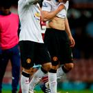 Wayne Rooney and Phil Jones of Manchester United leave the pitch after the Barclays Premier League match between West Ham United and Manchester United