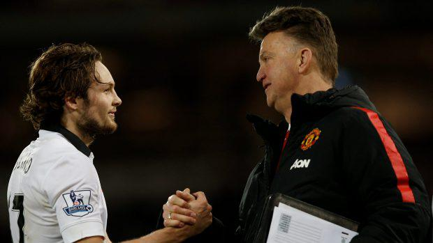 Manchester United's Dutch manager Louis van Gaal (R) shakes hands with goal-scorer Manchester United's Dutch midfielder Daley Blind