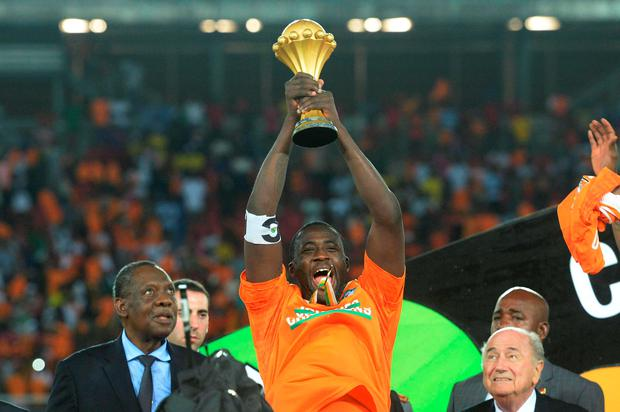 Ivory Coasts Midfielder Yaya Toure Raises The Trophy At End Of 2015 African Cup