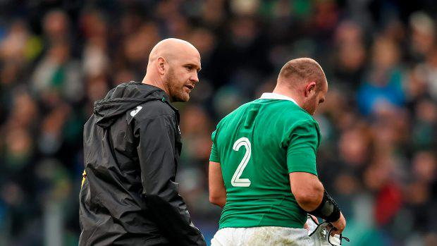 Rory Best, Ireland, leaves the field accompanied by Dr. Eanna Falvey, team doctor