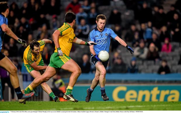 Jack McCaffrey races past Donegal's Michael Murphy on his way to score Dublin's second goal in the 63rd minute