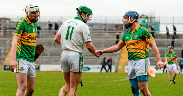 Henry Shefflin, Ballyhale Shamrocks, exchanges a handshake with Gort's Tadgh Linnane, right, and Conor Helebert, after the game