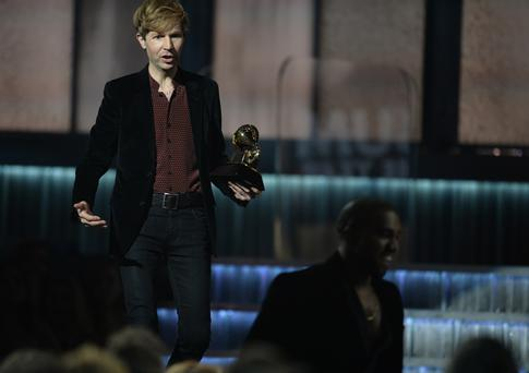Winner for Album Of The Year Beck reacts as Kanye West leaves the stage at the 57th Annual Grammy Awards in Los Angeles February 8, 2015. AFP PHOTO / ROBYN BECK