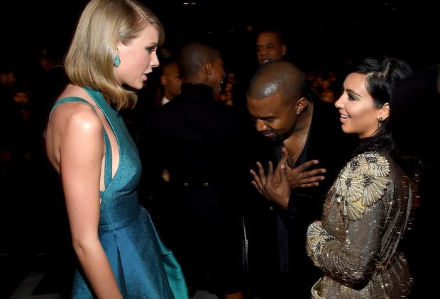 (L-R) Recording Artists Taylor Swift, Kanye West and tv personality Kim Kardashian attend The 57th Annual GRAMMY Awards at the STAPLES Center on February 8, 2015 in Los Angeles, California. (Photo by Larry Busacca/Getty Images for NARAS)