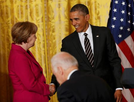 U.S. President Barack Obama and German Chancellor Angela Merkel shake hands at the conclusion of a joint news conference in the East Room of the White House in Washington February 9, 2015. REUTERS/Kevin Lamarque (UNITED STATES - Tags: POLITICS CIVIL UNREST)