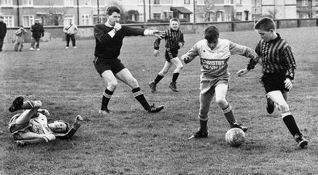Robbie Keane, left, lies on the ground during an U-12 game between Crumlin and Cherry Orchard in Pearse Park.