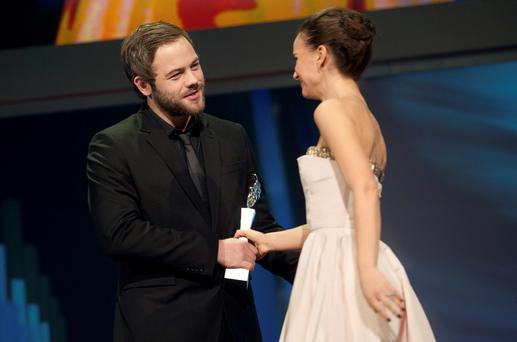 (L-R) Actor Moe Dunford of Ireland, one of the winners of the Shooting Stars Award, receives his award from actress Natalie Portman at the presentation ceremony during the 65th Berlinale International Film Festival in Berlin February 9, 2015.