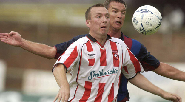 Liam Coyle, Derry City, in action against Barcelona's Patrick Andersson during a friendly in 2003