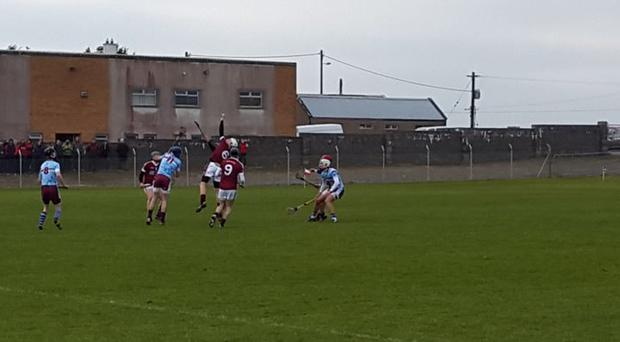 NUI Galway centre back Conor Cleary climbs highest to catch the sliotar in Fitzgibbon Cup action against GMIT at Carnmore. Photo: Declan Rooney.