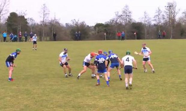 Jordanstown and DIT players battle for possession