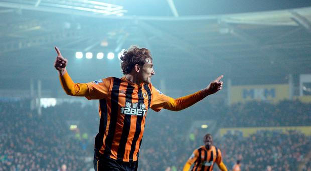 Hull City's Croatian striker Nikica Jelavic celebrates scoring against Aston Villa