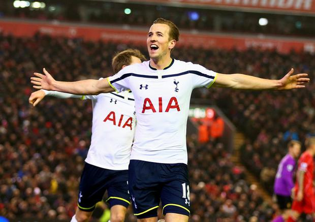 Harry Kane celebrates scoring against Liverpool at Anfield