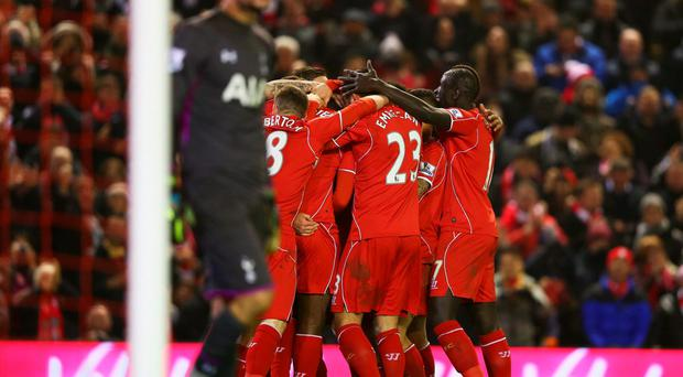 Liverpool players celebrate the goal scored by Mario Balotelli against Tottenham Hotspur at Anfield