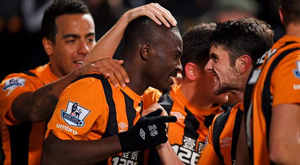 Dame N'Doye celebrates with his teammates after scoring Hull City's second goal in their Premier League clash with Aston Villa at the KC Stadium. Photo: Laurence Griffiths/Getty Images