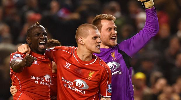Mamadou Sakho, Martin Skrtel and Simon Mignolet celebrate Liverpool's victory over Tottenham at Anfield