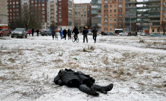 The body of a woman killed by recent shelling lies on the ground in the residential sector in the town of Kramatorsk in Ukraine