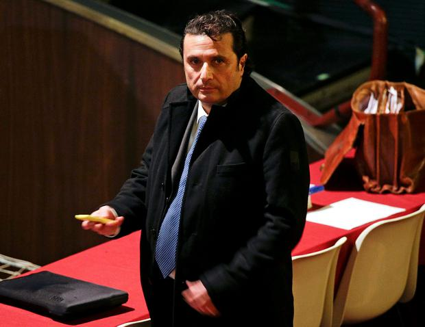 Captain of the Costa Concordia cruise liner Francesco Schettino stands in court during his trial in Grosseto. An Italian prosecutor has asked the court to sentence Schettino to more than 26 years in jail for his role in the 2012 disaster that killed 32 people