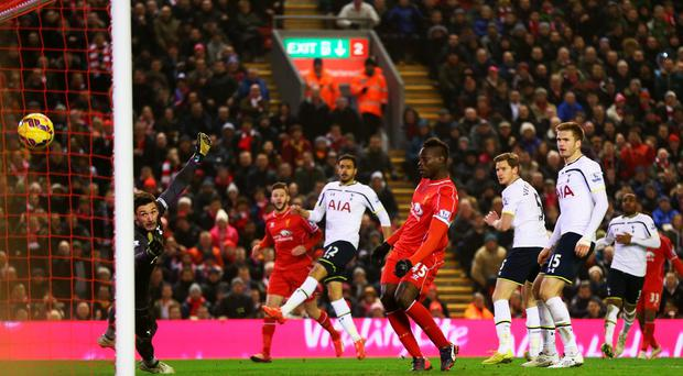 Mario Balotelli turns the ball home for Liverpool's winning goal in their Premier League clash with Tottenham Hotspur at Anfield. Photo: Clive Brunskill/Getty Images