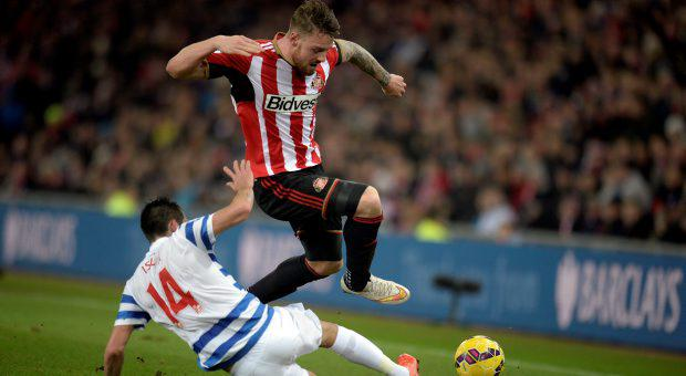 Sunderland's Connor Wickham and Queens Park Rangers' Mauricio Isla (floor) during the Barclays Premier League match at the Stadium of Light