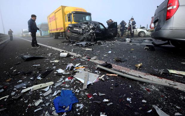 Wreckage are scattered on the road near damaged vehicles on Yeongjong Bridge in Incheon February 11, 2015. A traffic pileup involving more than 100 vehicles on the bridge on Wednesday killed at least two people and injured more than 30 people, according to local news reports. REUTERS/Park Jung-ho/News1