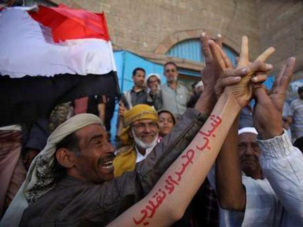 Yemenis rallying against the Houthi takeover and parliament dissolution
