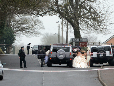 Members of the wedding party leave the church after the shooting in Co Fermanagh during the week. Photo by Ronan McGrade/Pacemaker Press