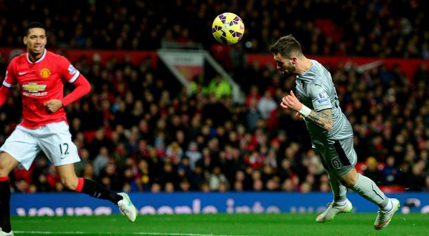 Danny Ings of Burnley scores against Manchester United Old Trafford with a diving header.