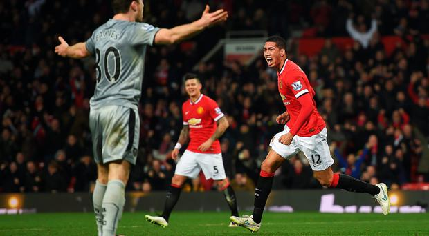 Chris Smalling celebrates his second goal against Burnley at Old Trafford