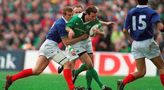Geordan Murphy, Ireland is tackled by Aurelien Rougerie, France in 2003