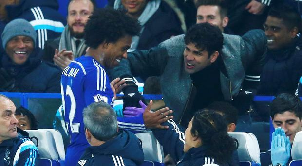 Diego Costa congratulates Willian of Chelsea after he scored a dramatic winner against Everton.