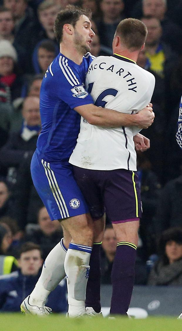Chelsea's Serbian defender Branislav Ivanovic clashes with Everton's James McCarthy at Stamford Bridge. McCarthy earned a yellow card for the incident.