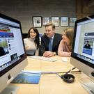 Pictured ahead of his Inaugural Lecture as Adjunct Professor of Public Service Broadcast Journalism at UL is Professor Bryan Dobson with journalism students Hilary McGann (left) and Monika Gaciarz. Photo: Sean Curtin