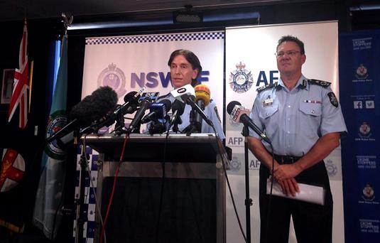 Australian Federal Police Deputy Commissioner Michael Phelan (R) listens as New South Wales Deputy Police Commissioner Catherine Burn speaks during a media conference in Sydney. Australian counter-terrorism thwarted an imminent attack linked to the Islamic State militant group after arresting two men in Sydney. Australia has been on heightened alert for attacks by home-grown Islamist radicals. It raised its national terror threat level to 'high' for the first time in September, when hundreds of police conducted raids after receiving information that a radical group planned to conduct a public beheading.