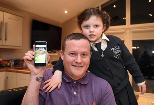 11 Feb 2014; Father Keith Doyle with his daughter Katie, 4, and a photo of his newborn son Bobby, born at home today. Kilnamanagh, Tallaght, Dublin. Picture: Caroline Quinn