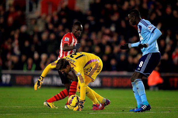 West Ham United goalkeeper Adrian battles for the ball with Southampton's Sadio Mane (rear) before being sent off for handball outside of the box