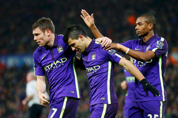 Manchester City's Sergio Aguero (C) celebrates after scoring a penalty against Stoke City