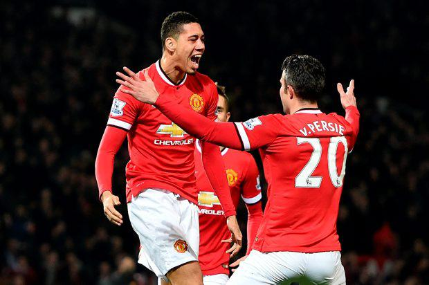Manchester United's Chris Smalling (left) celebrates scoring his side's first goal