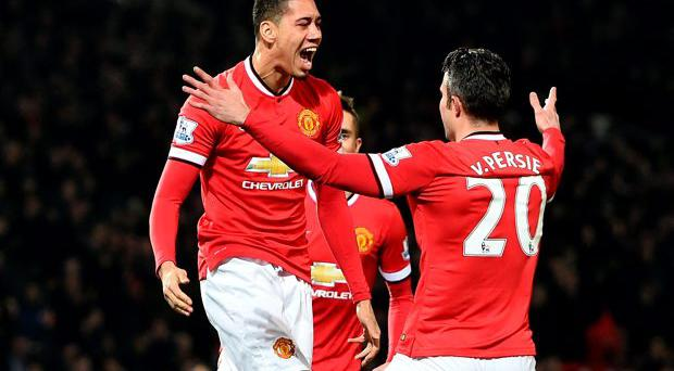 Manchester United's Chris Smalling (left) celebrates scoring his record-breaking goal