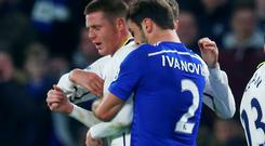 Branislav Ivanovic (R) of Chelsea grapples with Everton's James McCarthy during their English Premier League soccer match at Stamford Bridge