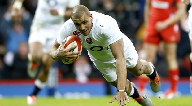 England's Jonathan Joseph scores a try against Wales during their Six Nations Rugby Union match at the Millennium stadium in Cardiff